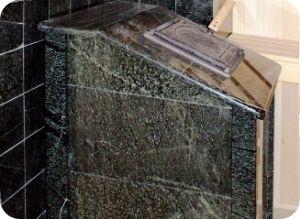 Банная печь в каменной облицовке из серпентинита